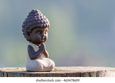 Baby buddha images stock photos vectors shutterstock silhouette of little buddha or baby practicing yoga meditate and pray on wooden surface m4hsunfo