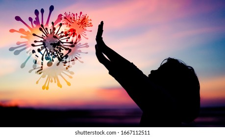 Silhouette Little Chinese girl raised hands for protection virus Covid-19.Kid girl praying in the sunset sky for a new day freedom to corona covid19 virus.Little asian girl hand praying for thank GOD.