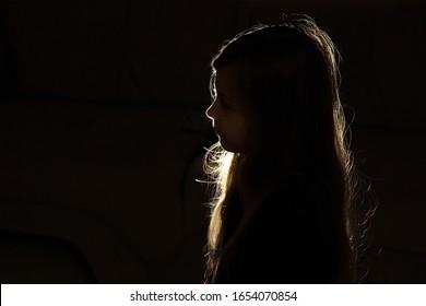 Silhouette little girl in the dark, little girl in the night