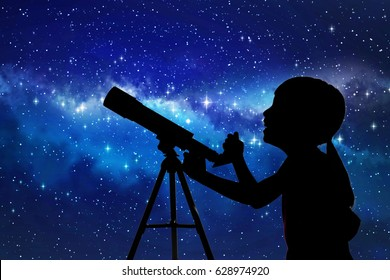 Silhouette of little girl looking through a telescope at the stars background