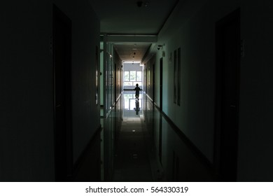 Silhouette a lonely young boy inside a building