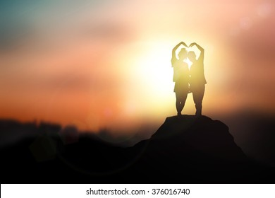 Silhouette in love  on the sunset background on Valentine's Day.