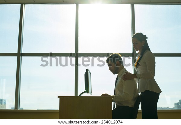 Silhouette lovely romantic couple in office room space Isolated on white Businesswoman touch shoulder business man against sun shine rays and blue sky window background Empty space for inscription