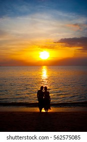 Silhouette of the lover standing at the beach during beautiful sunset.