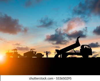 Silhouette machinery work construction road plan to connect Heavy industry and safety at work concept and support transportation business and journalism over blurred natural background sunset pastel.