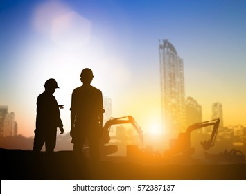Silhouette machinery work construction road plan to connect and Heavy industry and safety at work concept support transportation business and journalism over blurred natural background sunset pastel