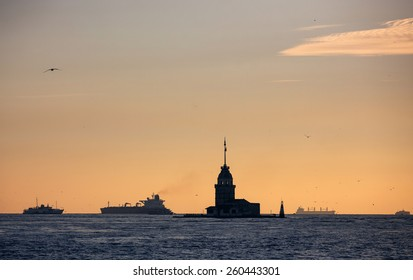 Silhouette of Maiden's Tower and ships in Bosporus sea channel, Istanbul