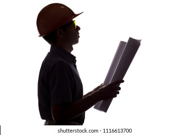 silhouette of male construction engineer with building project on paper, man in formal clothes and helmet control the work, concept of construction and engineering on white isolated background
