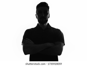 Silhouette of male person with arms crossed over white