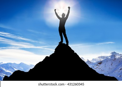 Silhouette Of A Man After Succeeded Climbing Against Snowy Mountains