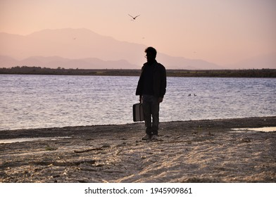 Silhouette of a man in the afternoon sunset in the Salton sea, California.