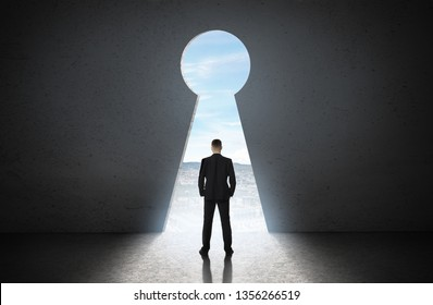 Silhouette of man against giant keyhole door. Access is allowed concept