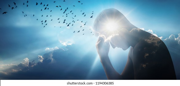 Silhouette of a man against a sky, sun and a flock of birds. Ideas on emotion or psychology, philosophical and scientific concepts.