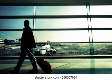 Silhouette of a man at the Airport with Suitcase