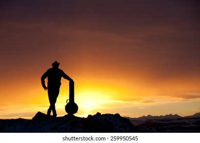 Silhouette of Man With Banjo