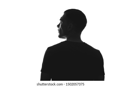 silhouette of man from behind on white background looks away