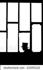Silhouette of the man in black at the window