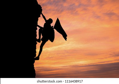 A silhouette of man climbing on mountain top over sunset background, Business, success, leadership, achievement, attempt, patient, endeavor and people concept.