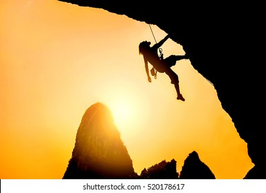 Silhouette of man climbing at sunset. Extreme sport concept. Rock climbing in Thailand