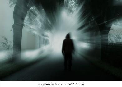 silhouette of man in dark atmosphere