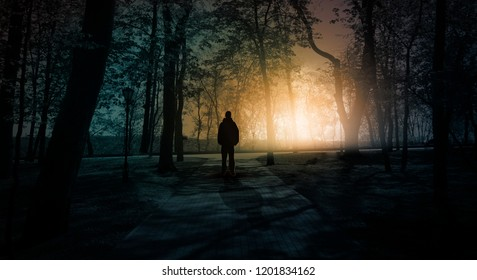 Silhouette of a man in a dark, gloomy forest.