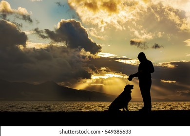 Silhouette Man And Dog