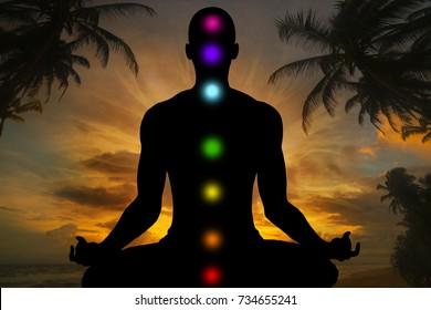 Silhouette of man doing yoga