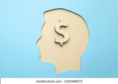 Silhouette of a man with dollar sign in the brain. Money in my head