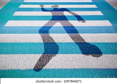 Silhouette of man drawn on a blue and white paved road - concept image