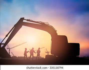 Silhouette man engineer looking construction worker in a building site over Blurred construction worker on construction site