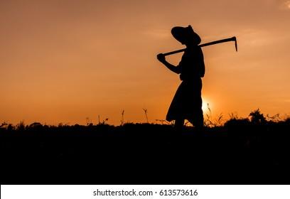 Silhouette Man in farm on sunset, myanmar,farmer,sunrise,field, silhouette,thai,man