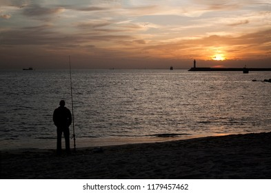 Silhouette of man fishing in the Mediterranean Sea at sunset. Photo taken in Almeria, Andalusia, Spain.