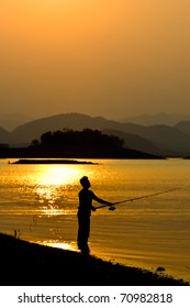 Silhouette of a man fishing in a sunset, Thailand