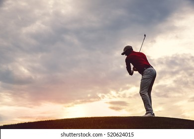 silhouette of man golfer with golf club at sunset