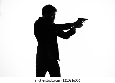 silhouette of a man with a gun in his hand