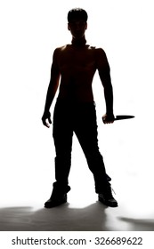 silhouette of a man holding knife