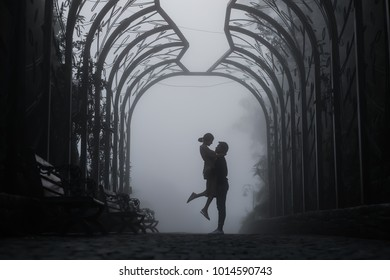 Silhouette of man holding woman in the dark with mist background, love couple shadow in the fog
