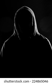 Silhouette of man in a hooded sweatshirt with text space