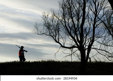 A silhouette of a man hunting