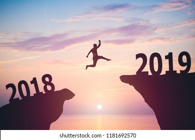 Silhouette of man jumping from 2017 to 2018 text