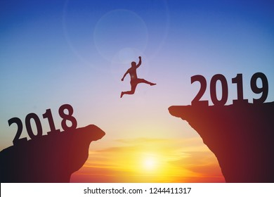 Silhouette of man jumping from 2018 to 2019 text