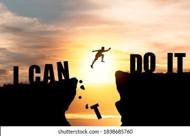 Silhouette man jumping over cliffs for I can do it , good mindset by never give up concept.
