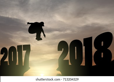Silhouette of a man leaping across a gorge from 2017 to 2018 for the concept: leaping into the New Year 2018.