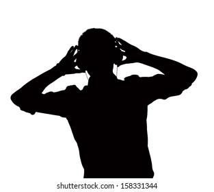 Silhouette of man listening to headphones