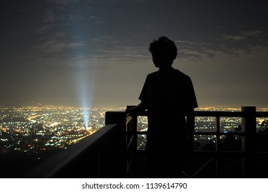 Silhouette man looking at night city and night sky backgound