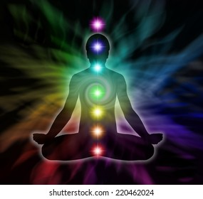 Silhouette  of a man in lotus meditation position with Seven Chakras on flowing rainbow energy background