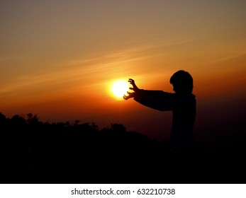 "Silhouette of a man mimicking the famous Japanese animation's ""KAMEHAMEHA"".  The picture implies ""Always enjoy and have fun with your life""."