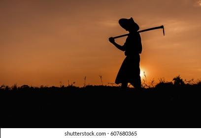 Silhouette man In myanmar. Silhouette Man in farm on sunset, myanmar,farmer,sunrise,field, silhouette,thai,man