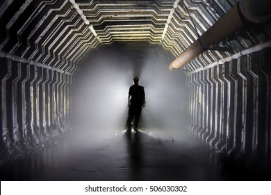 Silhouette of man on a background of an abandoned mine