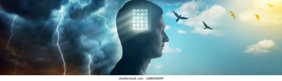 Silhouette of a man on the background of the prison bars, the sky and birds flying away as a symbol of freedom. Concept on the topic of psychology, psychiatry, religion.